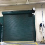 JEA: Powdercoated rugged Raynor Duracoil motor operated rolling steel door